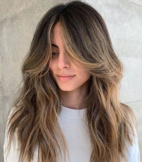 long brunette locks with soft honey balayage and curtain bangs, with textures are incredibly beautiful
