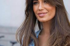 long dark brunette hair with texture and volume, with long curtain bangs looks incredibly chic and beautiful