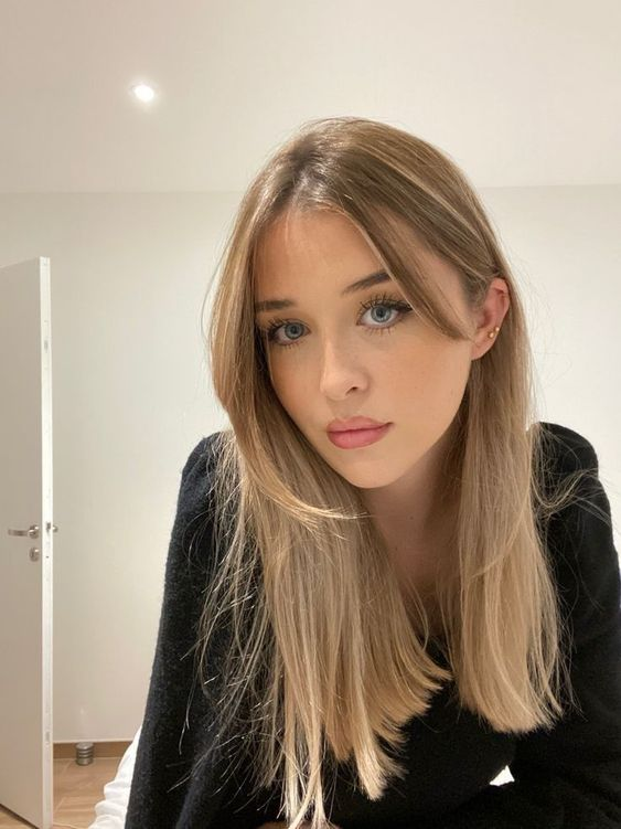 long locks with blonde balayage and curtain bangs is a lovely idea that works and looks very cute and chic