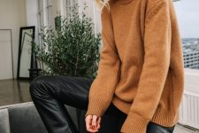 02 a beige sweater, black leather trousers and black lacquer Chelsea boots with kitten heels fore amazing