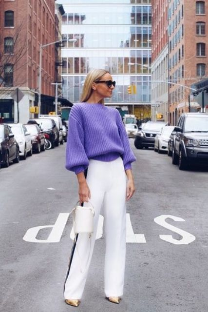 a bold fall look with a lilac chunky sweater, white and black stripe trousers, gold shoes and a white bucket bag