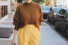 03 a brown oversized turtleneck, marigold wide leg trousers, a brown bag for a bold and catchy fall work look