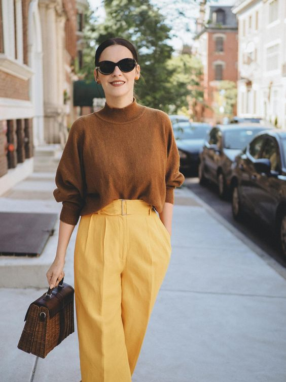 a brown oversized turtleneck, marigold wide leg trousers, a brown bag for a bold and catchy fall work look