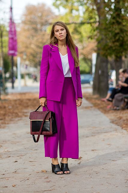 a bold purple pantsuit with an oversized blazer, culottes, a white top, black mules and a two tone bag for fall