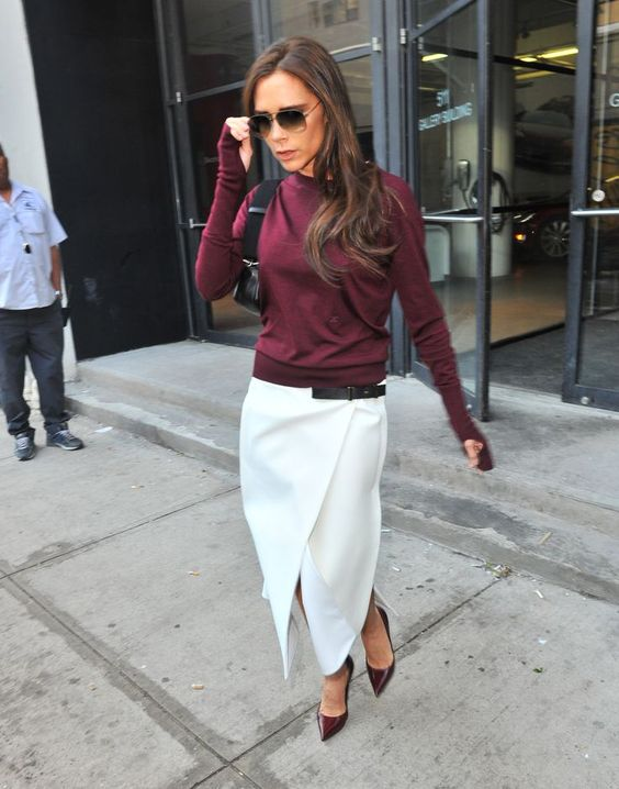 a burgundy sweatshirt, a white wrap midi skirt, burgundy shoes and a black bag for a refined work look in the fall