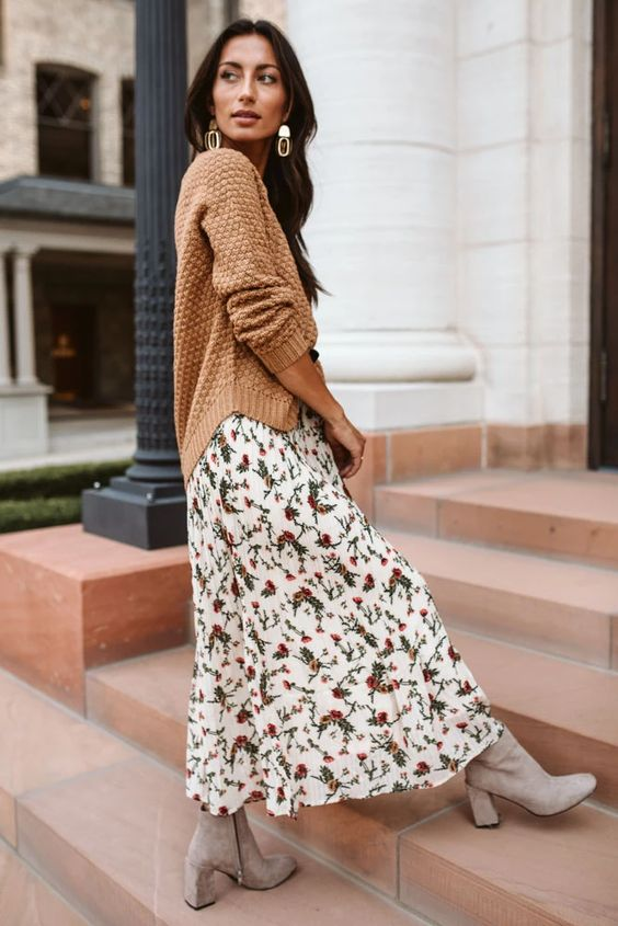 a pretty fall outfit with a white floral maxi dress, a beige jumper, light grey suede booties and statement earrings