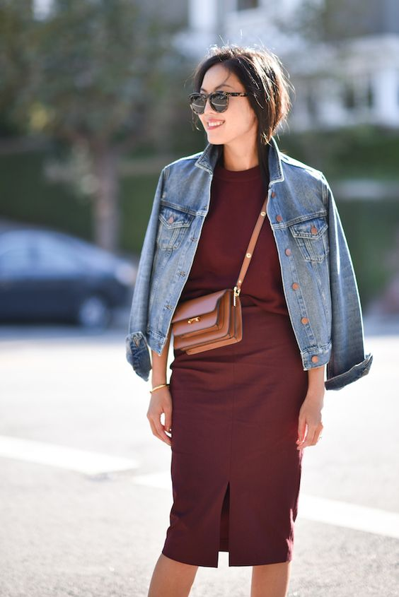 a burgundy jumper, a matching midi pencil skirt, a blue denim jacket and a beige bag for the fall
