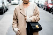 05 a casual look with a neutral top, navy jeans, a tan short coat, a black bag and a choker