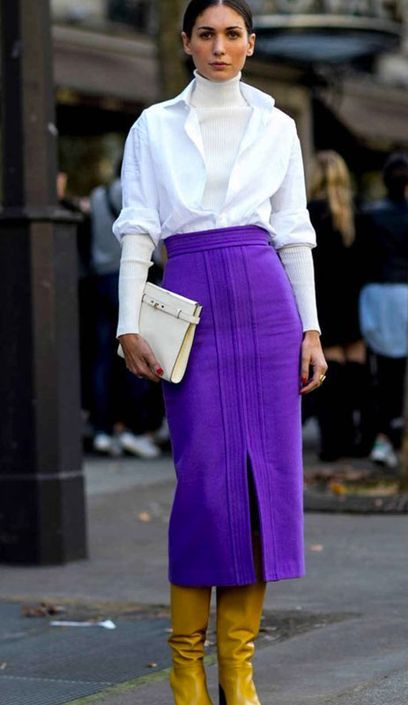 a catchy and bold fall outfit with a white turtleneck and a white, a violet midi skirt, yellow boots and a white clutch