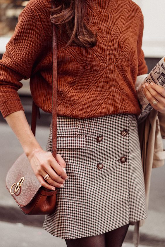 a cozy fall outfit with a rust-colored jumper, a plaid mini skirt, a brown bag is suitable for work, too