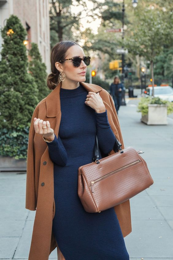 a fitting navy midi dress, statement earrings, a brown coat and a matching bag for a super elegant fall look