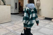05 a grey hoodie, a plaid shirt jacket, black leather trousers, white sneakers and a black mini bag for a comfy fall look