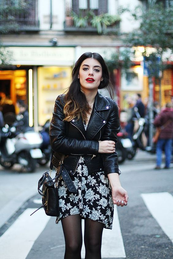 a black floral mini dress, a black leather jacket, black tights and a black bag plus a red lip to rock in the fall
