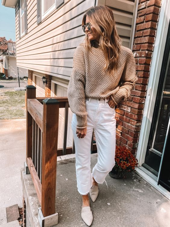 a casual neutral outfit with a tan sweater, white jeans, neutral slipper mules is a cozy and comfy idea