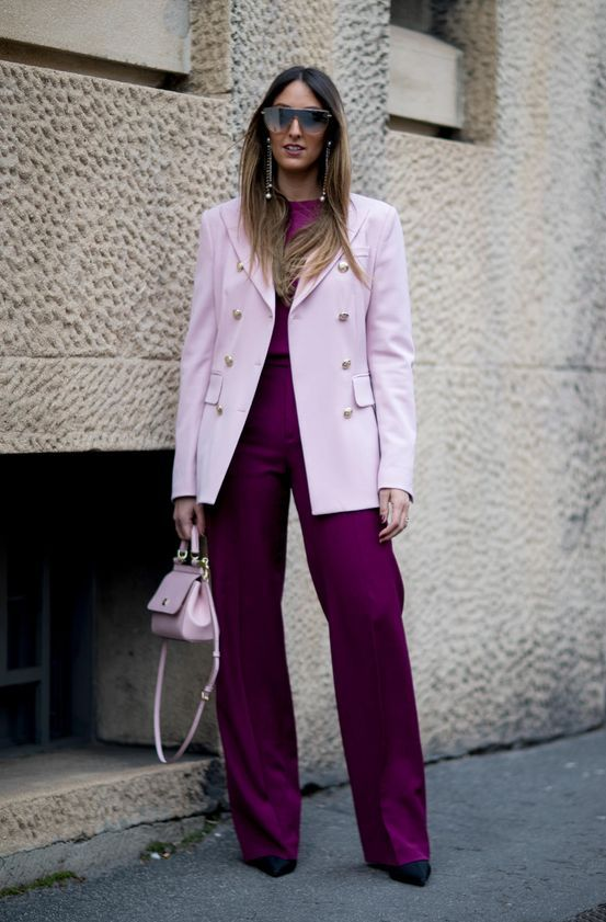 a chic fall work outfit with a purple top and trousers, a pale pink oversized blazer, black shoes and a pale pink bag