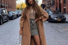 06 a girlish look with a tan turtleneck, a grey plaid mini skirt, tan boots, a beige midi coat and a creamy bag