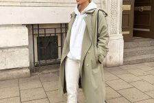 06 a grey hoodie, white jeans, white trainers, an olive green trench and a black bag for a super comfy college look