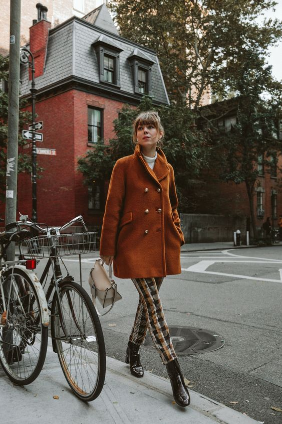 a catchy look with a vintage feel, with a white turtleneck, plaid trousers, black lacquer boots, a rust colored cropped coat and a creamy bag