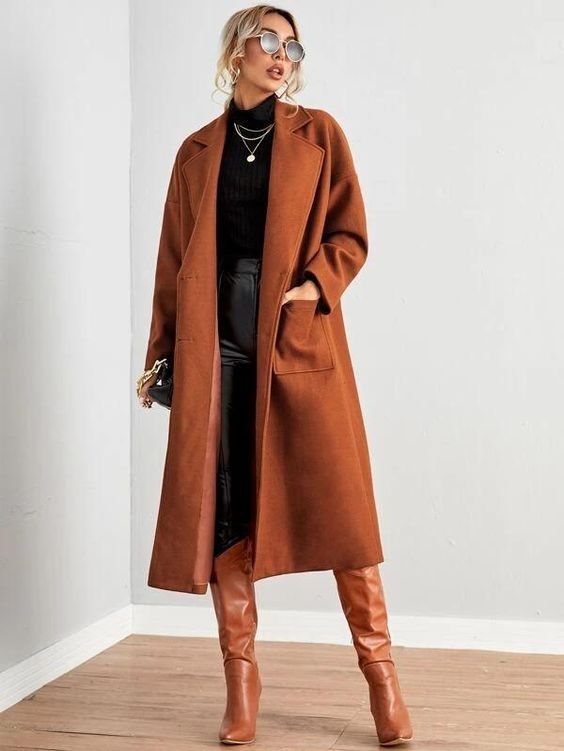 a lovely and edgy fall outfit with a black turtleneck and leather leggings, a brown midi coat and matching knee high boots