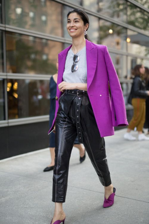 a super chic fall work outfit with a gre t-shirt, black leather trousers, an oversized purple blazer, purple mules
