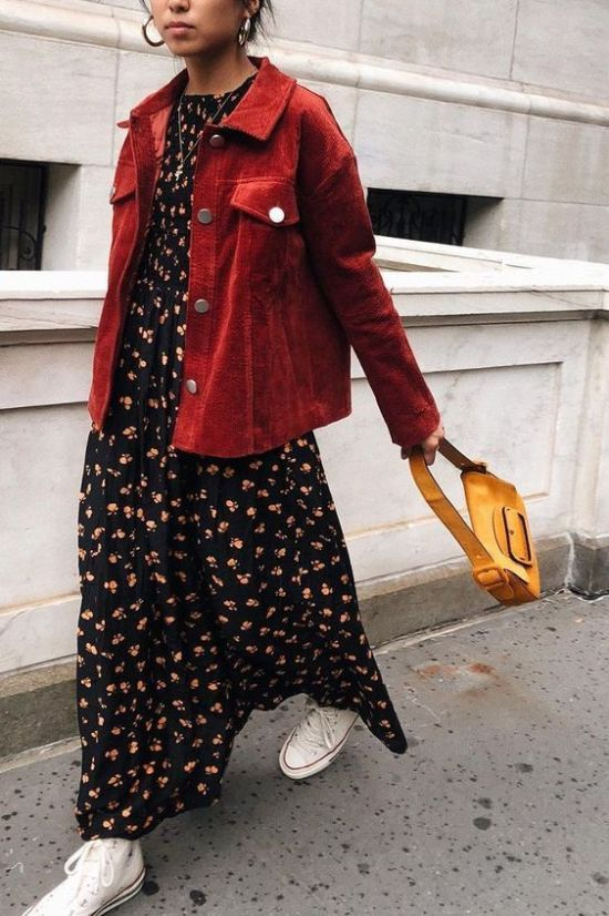 a bright fall outfit with a black floral maxi dress, a red leather jacket, white sneakers, a bright yellow mini bag