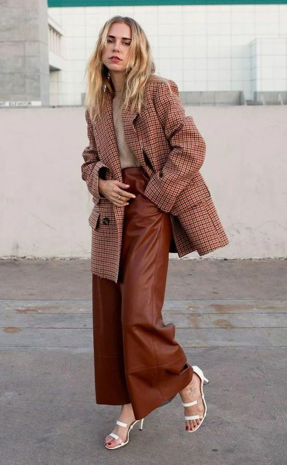 a light grey jumper, chocolate brown wide leg trousers, a burgundy plaid oversized blazer and white shoes
