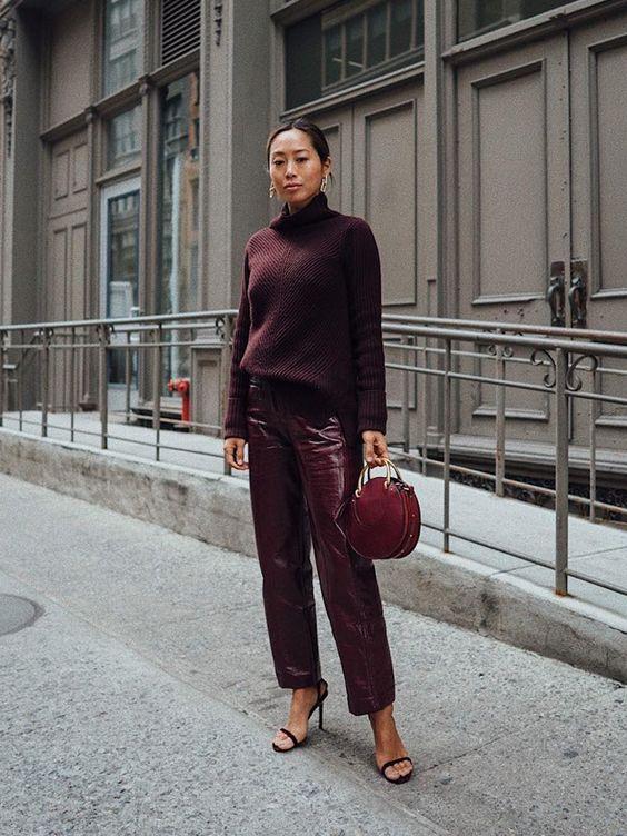 a deep purple sweater, burgundy vinyl pants, a fuchsia bag and black heels for a monochromatic fall look
