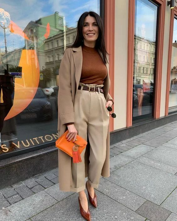 a stylish brown fall work outfit with an orange bag