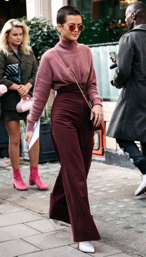 a dusty pink cahsmere turtleneck, burgundy high waisted trousers, white boots and a burgundy bag