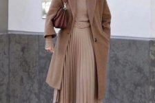 11 a pretty fall outfit with a tan turtleneck and a pleated midi skirt, a beige midi coat, grey boots and a brown bag