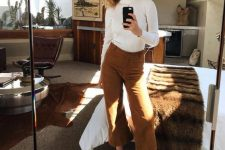 11 a white turtleneck, mustard-colored corduroy cropped pants, gold shoes and a delicate necklace for a comfy and chic look