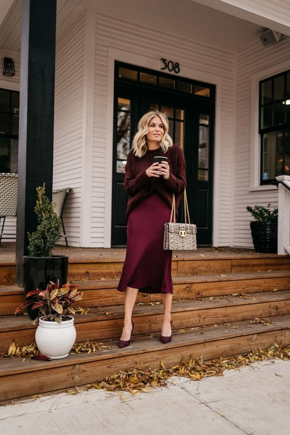 a girlish and cozy monochromatic burgundy look with a sweater, a slip midi skirt, heels and a snakeskin printed bag
