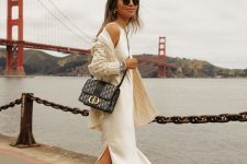 12 a pretty fall outfit with a white midi slip dress, a patterned creamy cardigan, black combat boots, a black printed bag