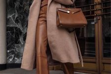 12 a refined modern look with a brown jumper and leather trousers, a beige midi coat, a brown tote and brown shoes