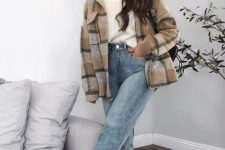 12 a simple and pretty college look with a white turtleneck sweater, blue jeans, a plaid shirt jacket, black boots and statement earrings