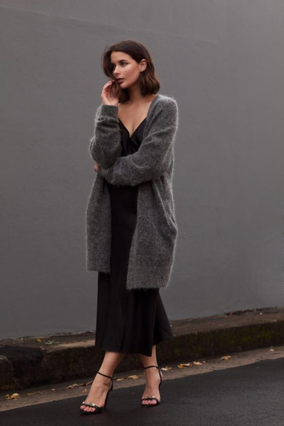 a black slip midi dress, black heels, a grey oversized cardigan for a comfy and very feminine fall outfit
