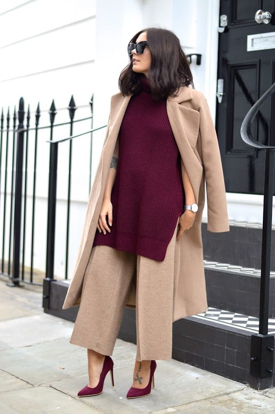 a gorgeous fall work outfit with tan wide leg trousers and a trench, a burgundy knit sleeveless sweater and matching shoes
