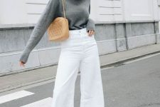 13 a grey turtleneck, white denim flare jeans, neutral suede booties and an amber mini bag for a cozy fall look