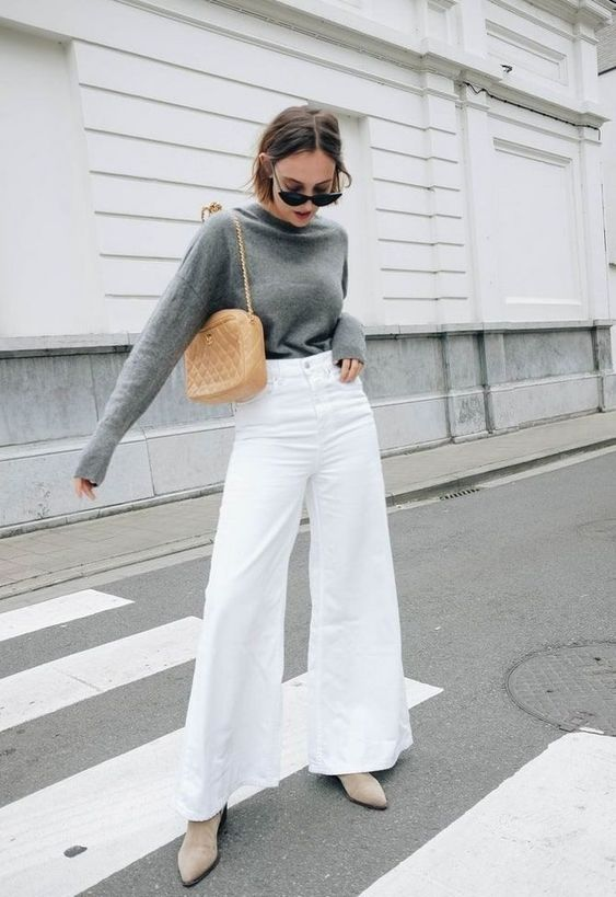 a grey turtleneck, white denim flare jeans, neutral suede booties and an amber mini bag for a cozy fall look