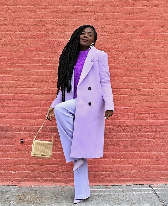 a dreamy fall work outfit with a purple sweater, lavender trousers, a coat, lavender shoes and a tan bag