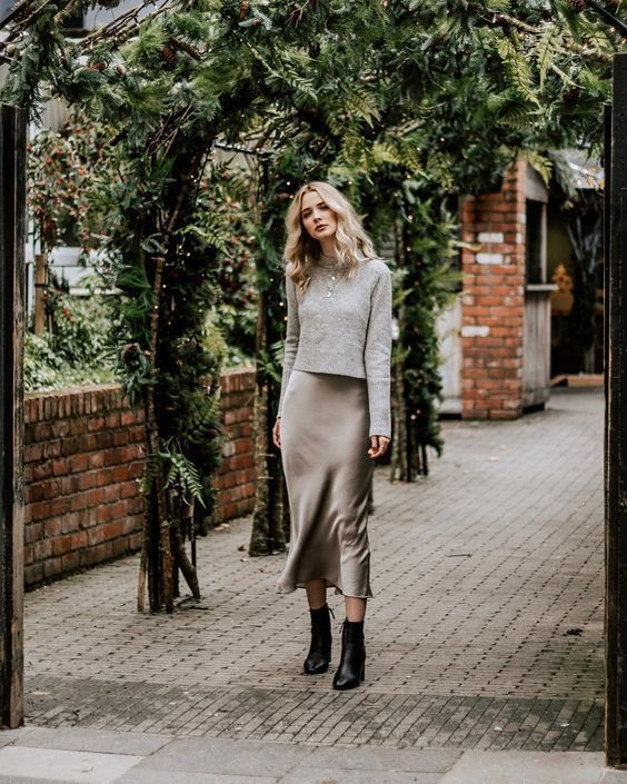 a pretty fall look with a grey slip midi dress, a grey jumper, layered necklaces, black boots is amazing for the fall