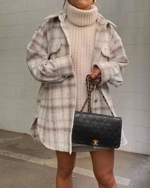 a white chunky sweater, a plaid mini, a plaid neutral shirt jacket and a black bag for a cold day in the fall