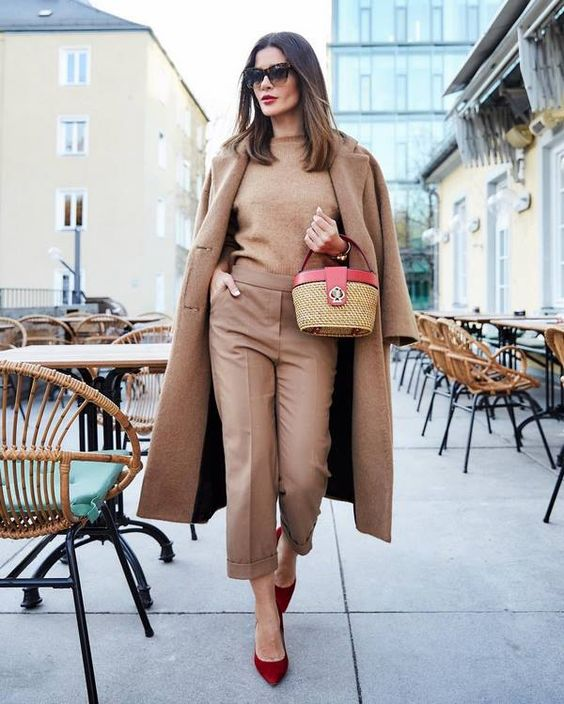 a total tan outfit with a jumper, trousers, a midi coat, burgundy suede shoes and a lovely basket bag