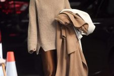 16 a beautiful monochromatic look with a chocolate brown slip midi dress, a tan oversized sweater, nude loafers and a beige coat by Jennifer Lawrence
