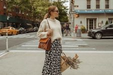 16 a feminine outfit with a black slip floral midi dress, a neutral jumper over it, a mustard-colored bag and matching booties