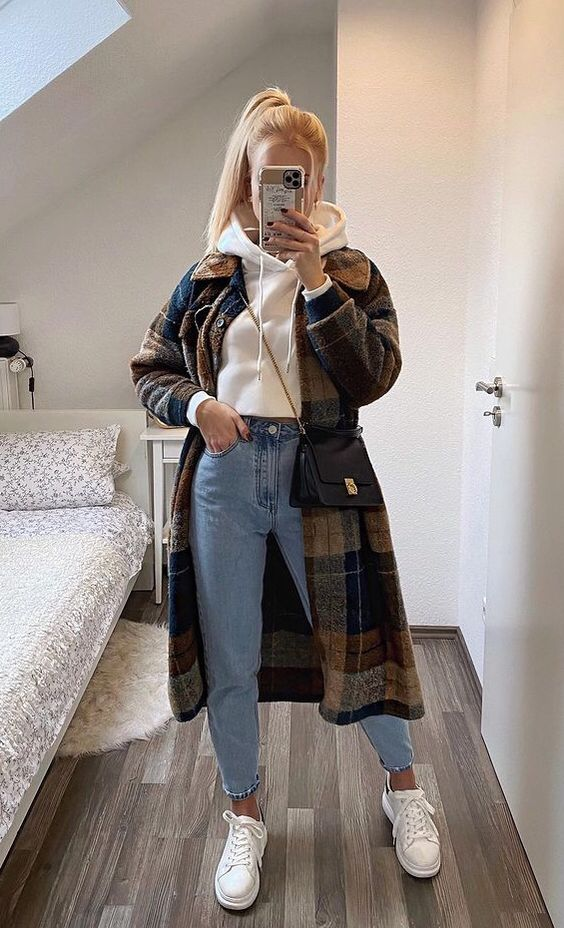 a white hoodie, blue jeans, white sneakers, a plaid coat and a black bag for going to classes and not only