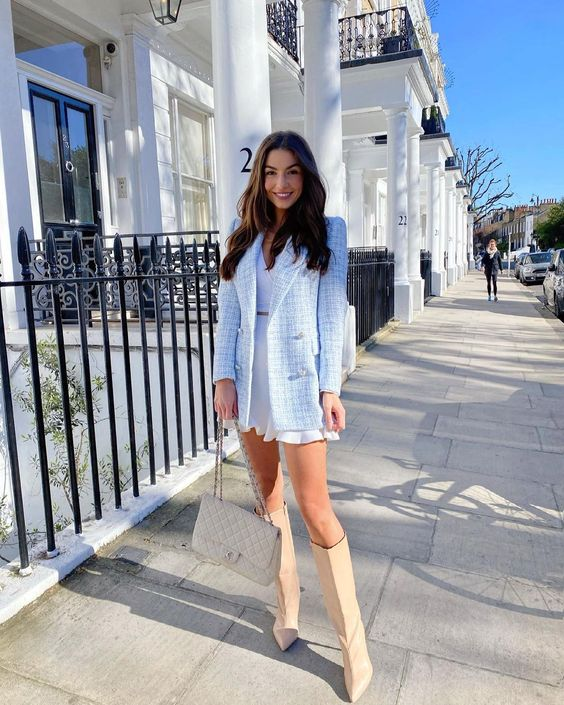 a girlish look with a white mini dress, a blue tweed blazer, nude slouchy boots and a neutral bag can be worn both to work and to a date
