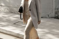 17 a neutral look for a warm day – a slip midi dress, an oversized blazer, white trainers and a small black bag