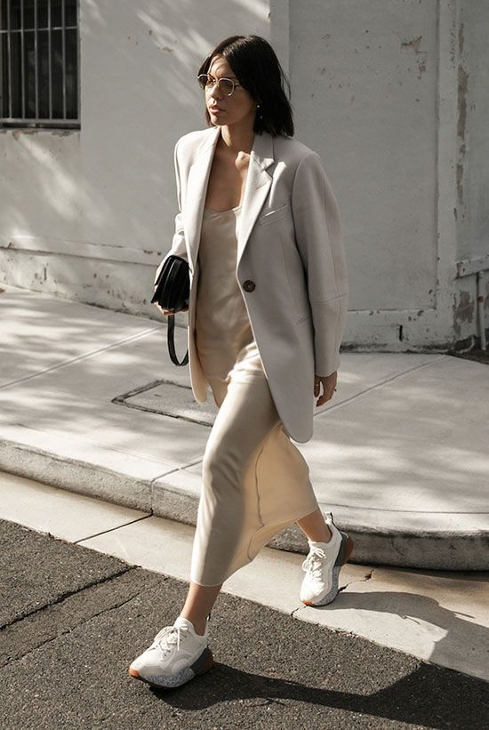 a neutral look for a warm day - a slip midi dress, an oversized blazer, white trainers and a small black bag