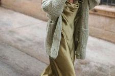 18 a gorgeous outfit with a green slip midi dress, a light green chunky cardigan, brown embellished heels for a date or party